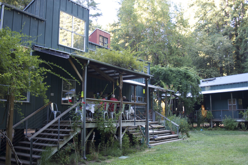 Wide covered porches of the Common House accommodate outdoor dining and chairs for conversation, and broad steps cascading down to the lawn make ideal seating for grandchildrens talent shows.